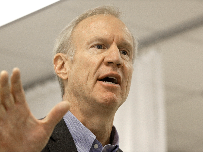 Gov Rauner holds his hands out in protest with his mouth open, ready to explain himself © WGLT