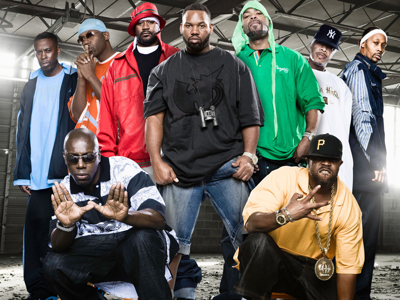 9 members of the Wu Tang Clan pose in a rundown concrete floored studio. © Thug Life Videos